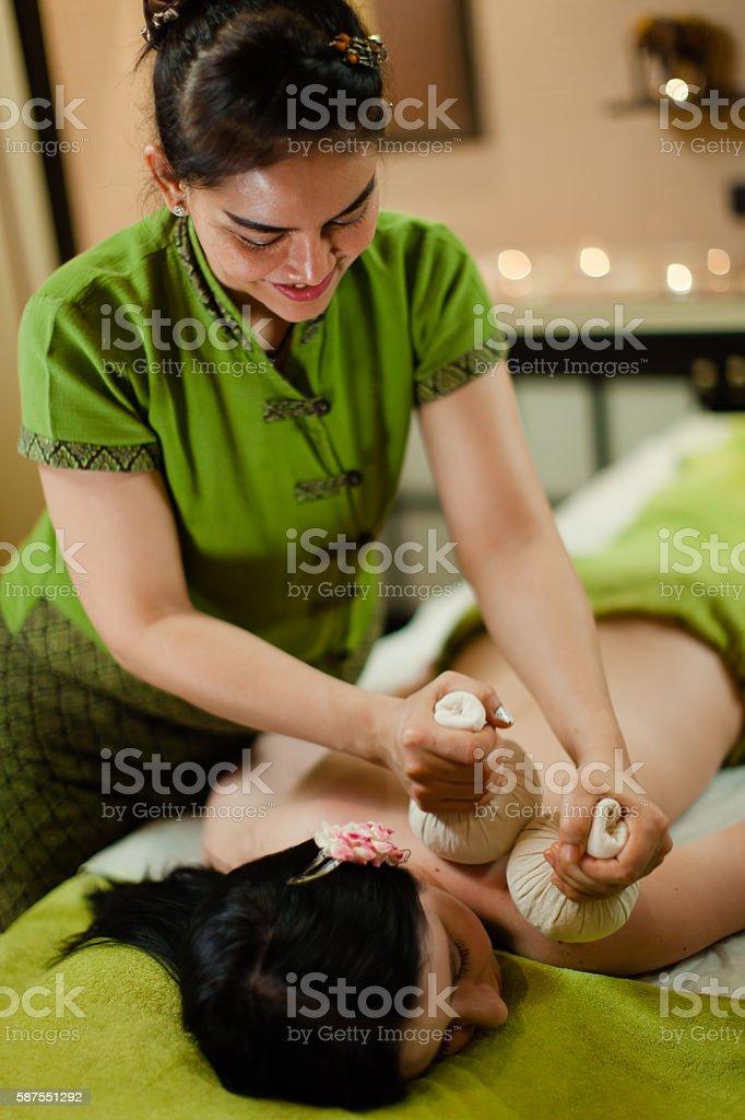 Thai herbal hot pack massage stock photo