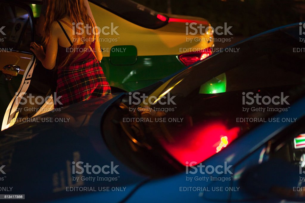 Thai hookers entering a taxi stock photo