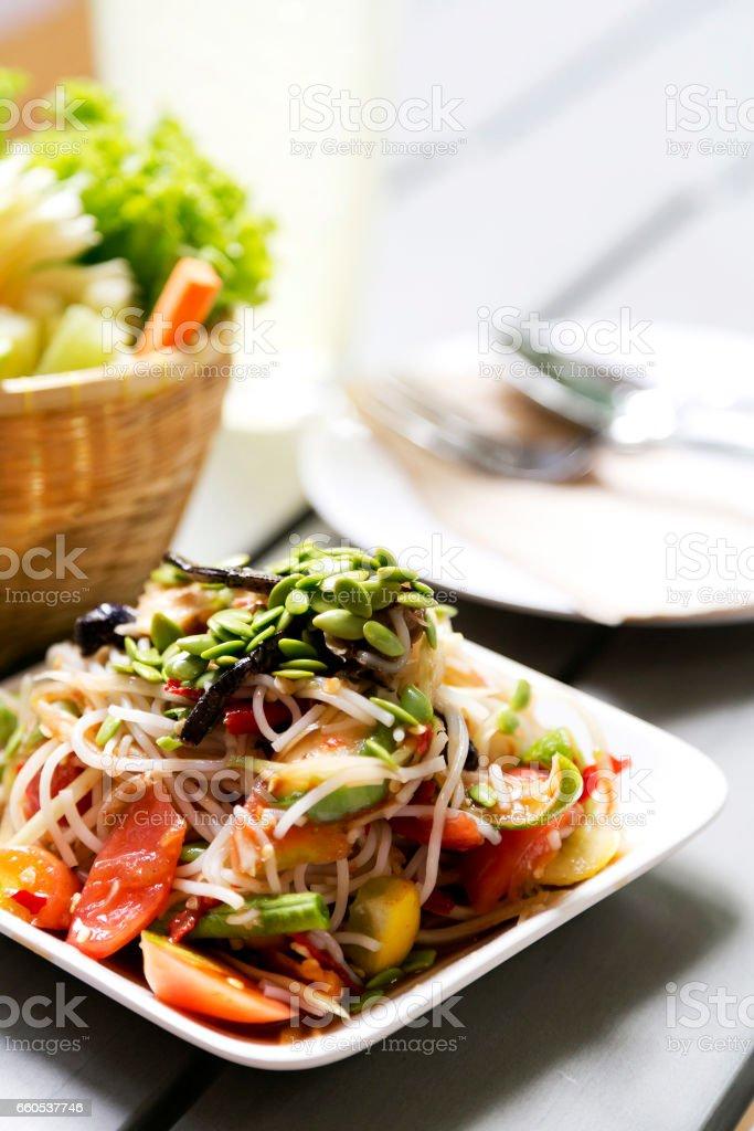 Thai hot and spicy delicious raw papaya salad stock photo