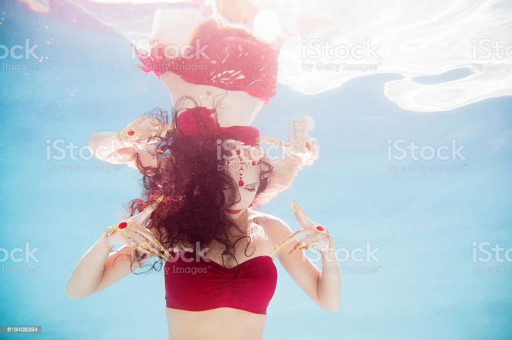 Thai Inspired Underwater Fashion Model stock photo