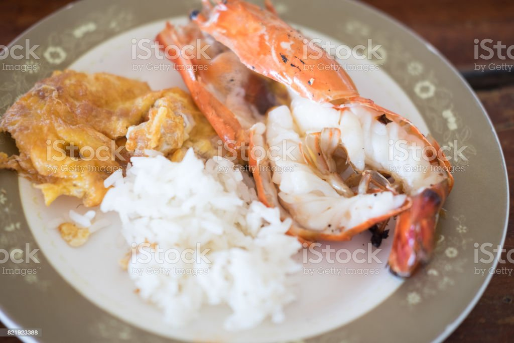 Thai Jasmine rice eating with river shrimp and omelet stock photo