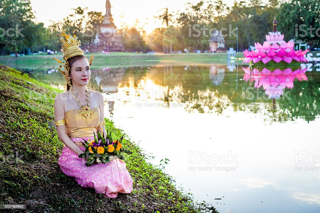 Thai lady with floating basket for Loi Krathong festival,Sukhothai stock photo