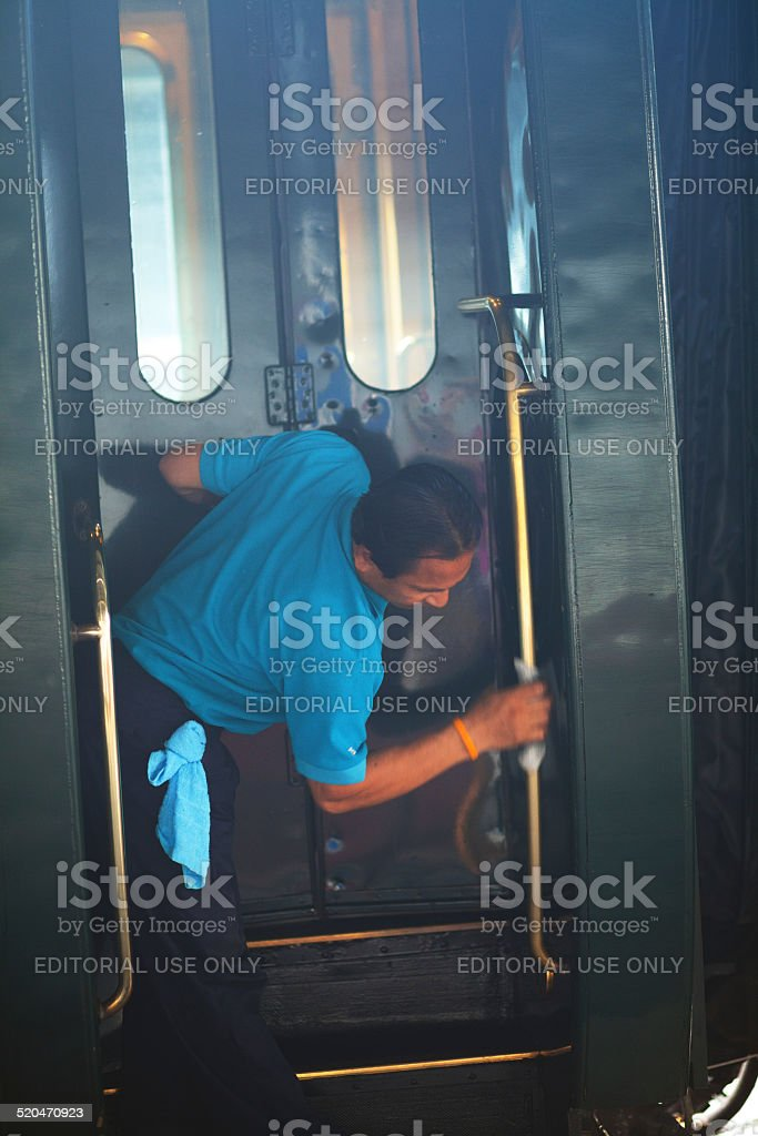 Thai man cleaning Eastern Oriental Express stock photo
