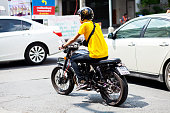 Thai man in yellow shirt on Stallions motorcycle