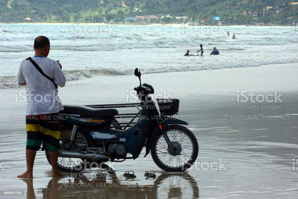 Thai man on Patong beach stock photo