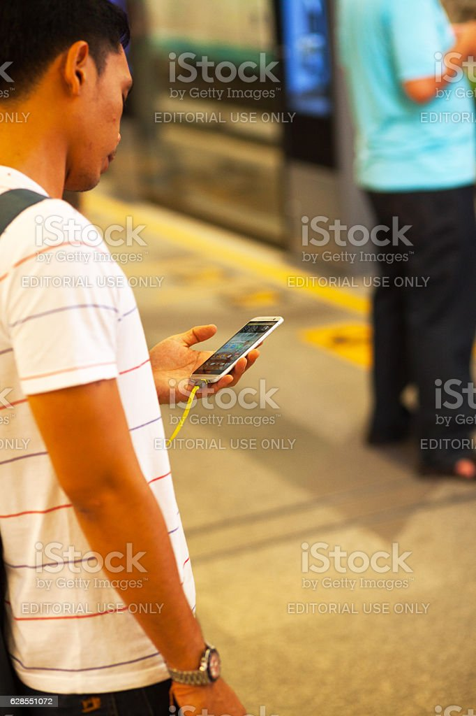Thai man using HTC mobile stock photo