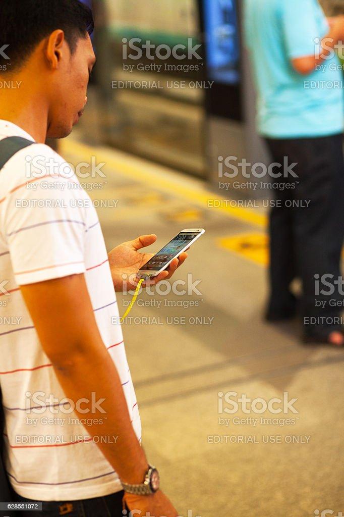 Thai man using HTC mobile stock photo