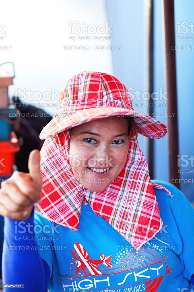 Thai market vendor with thumbs up stock photo