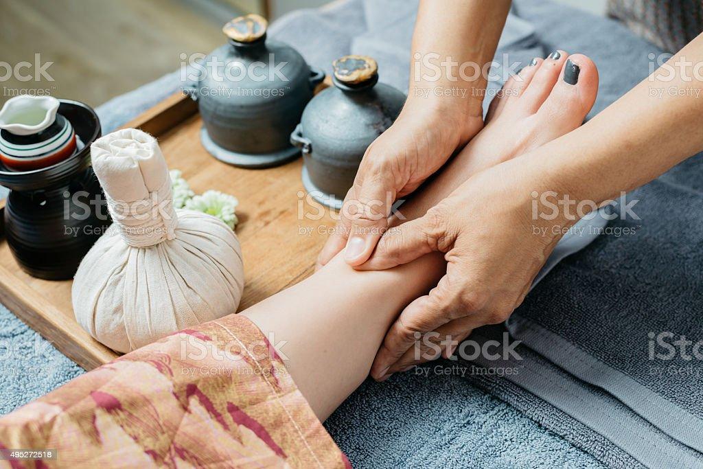 Thai massage series : Foot and leg massage stock photo