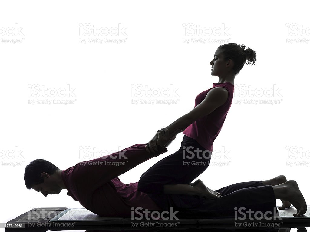 thai massage silhouette stock photo