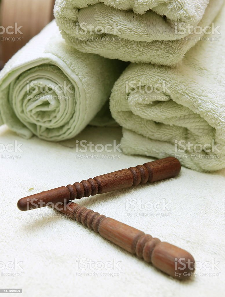 Thai massage sticks and towel royalty-free stock photo