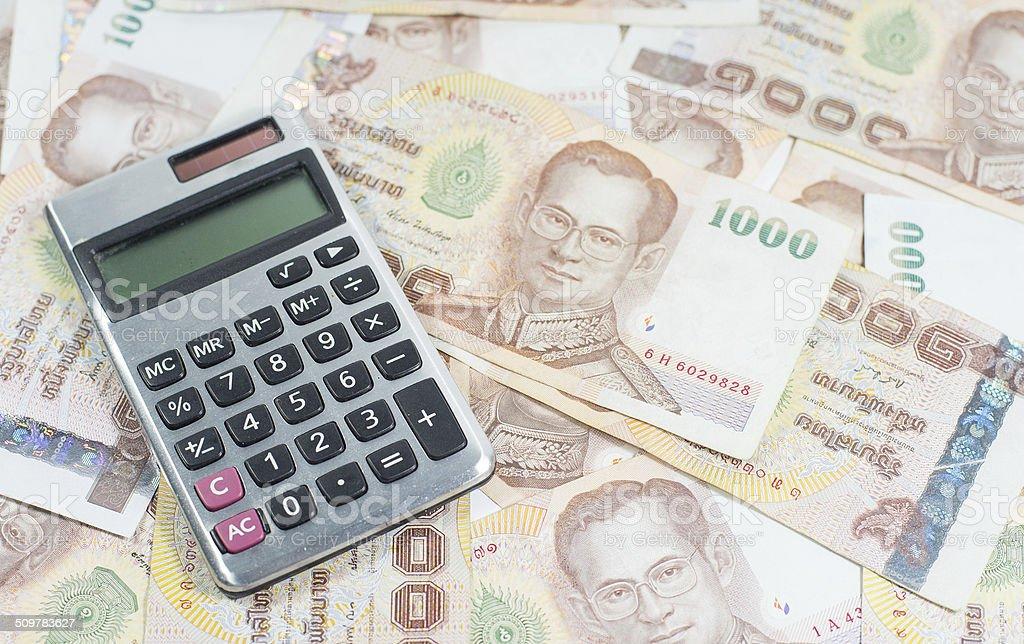 Thai money and Calculator stock photo