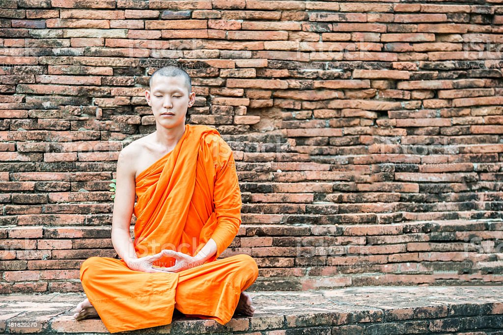 Thai monk meditation at temple in Ayutthaya, Thailand stock photo
