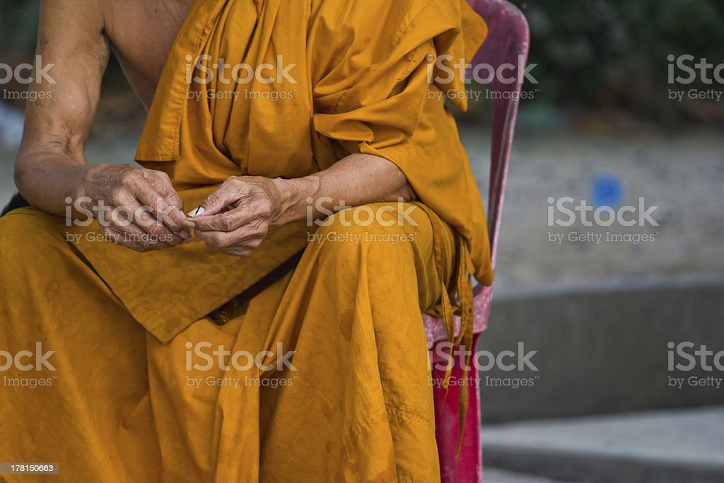 thai monk sits to smile royalty-free stock photo
