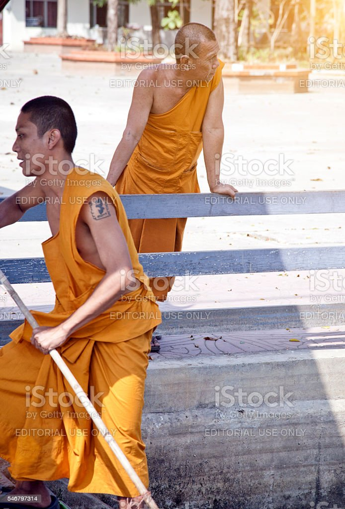 2 thai monks in Bangkok, cleaning the river. stock photo