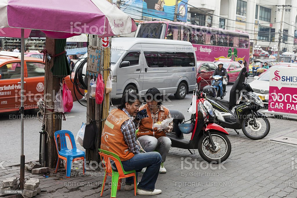 Thai motorbike drivers in Bangkok having a break. royalty-free stock photo