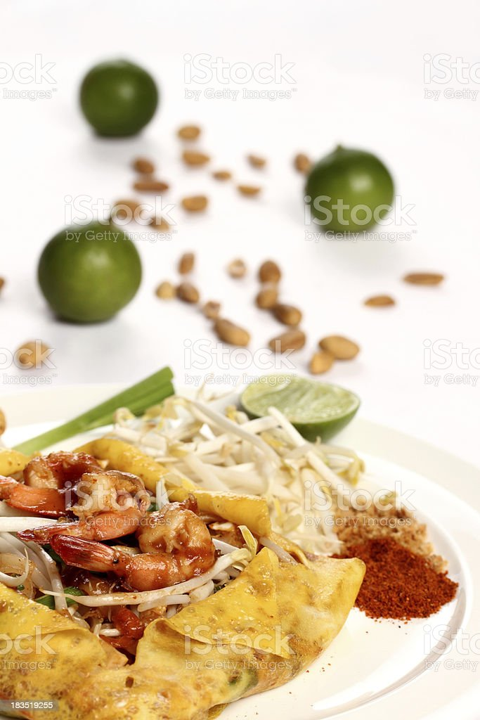 Thai noodle dish Pad Thai with prawns and omelet royalty-free stock photo