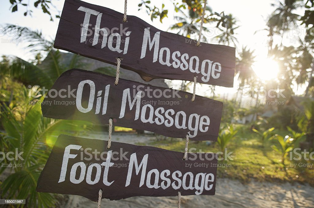 Thai Oil Foot Massage Sign on Bright Tropical Beach royalty-free stock photo