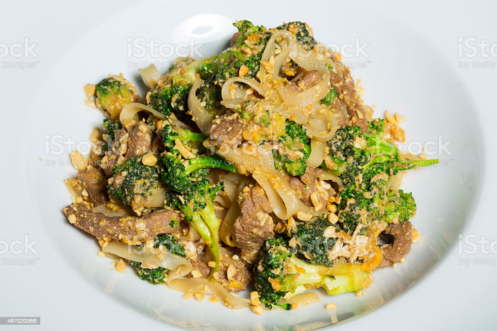 Thai Pad Satay - stir fry with broccoli and noodles stock photo