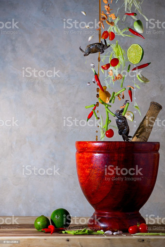 Thai papaya salad in floating motion stock photo