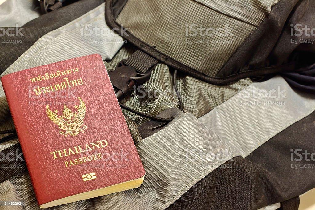 thai passport on shoulder bag stock photo