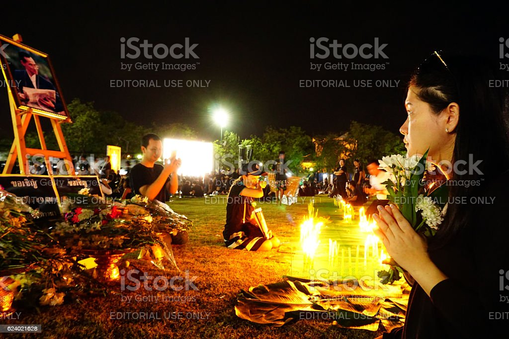 Thai people dressed in black at the Grand Palace stock photo