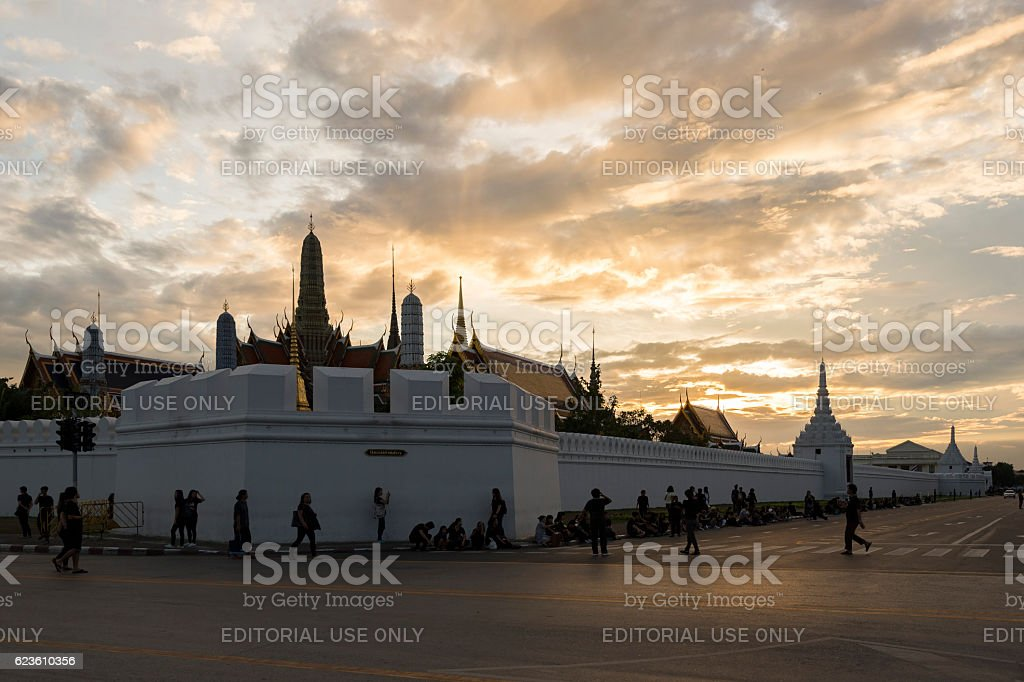 Thai people outside of Grand Palace moaning for the King stock photo