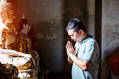 Thai People pray at temple in Ayutthaya, Thailand.