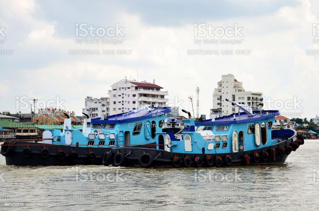 Thai people sailing Barge and Tug Boat cargo ship in Choaphraya river stock photo