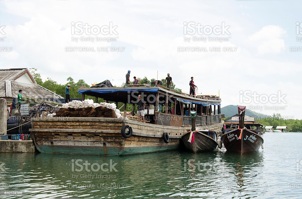 Thai people workers shipping product up and down from ship stock photo