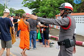 Thai police support people and Buddhist monks