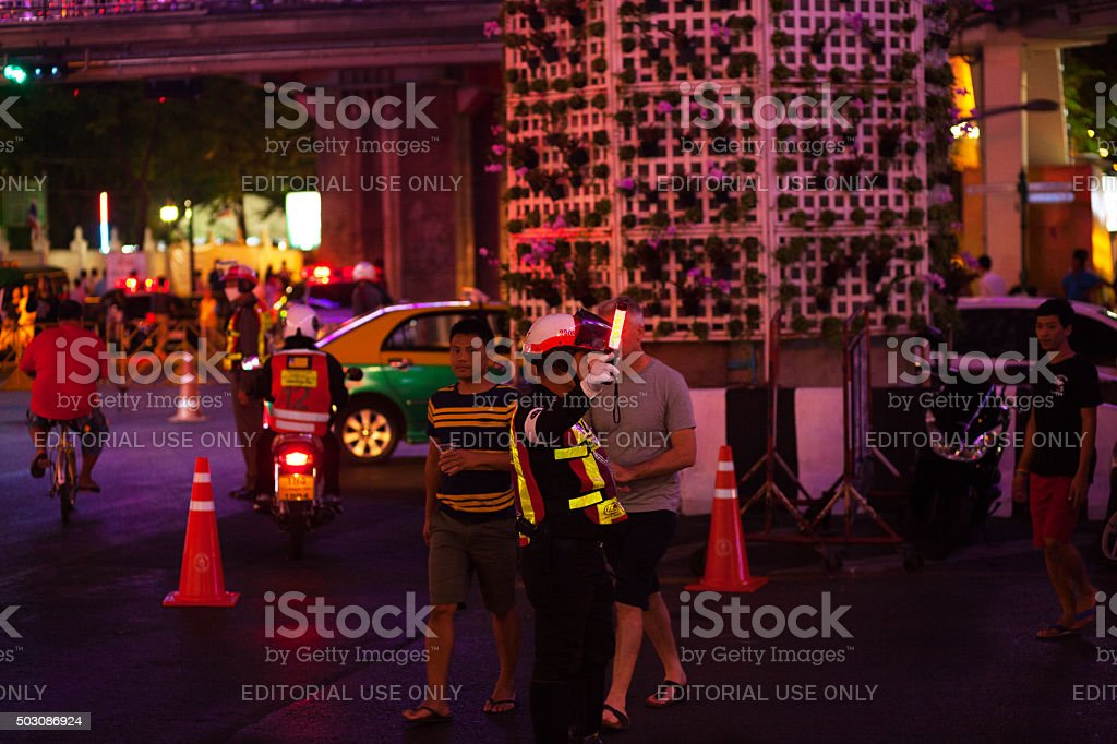 Thai policeman directing pedestrians and traffic stock photo