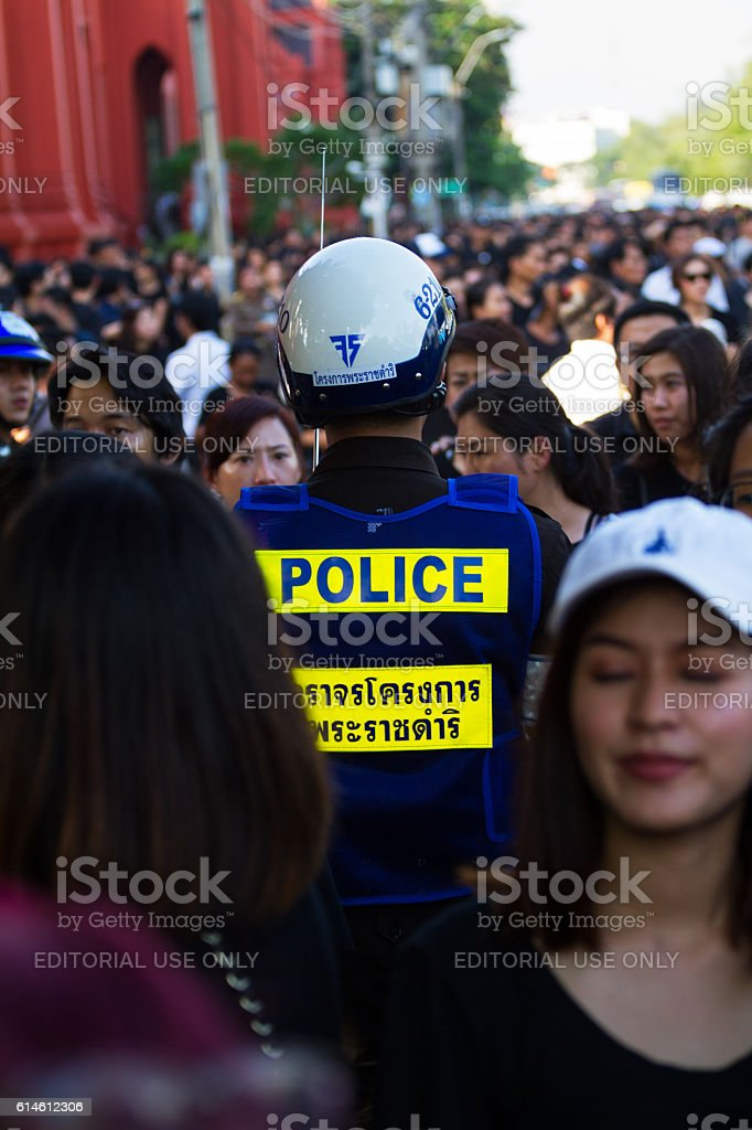 Thai policeman in crowd for condolence to King Bhumipol stock photo