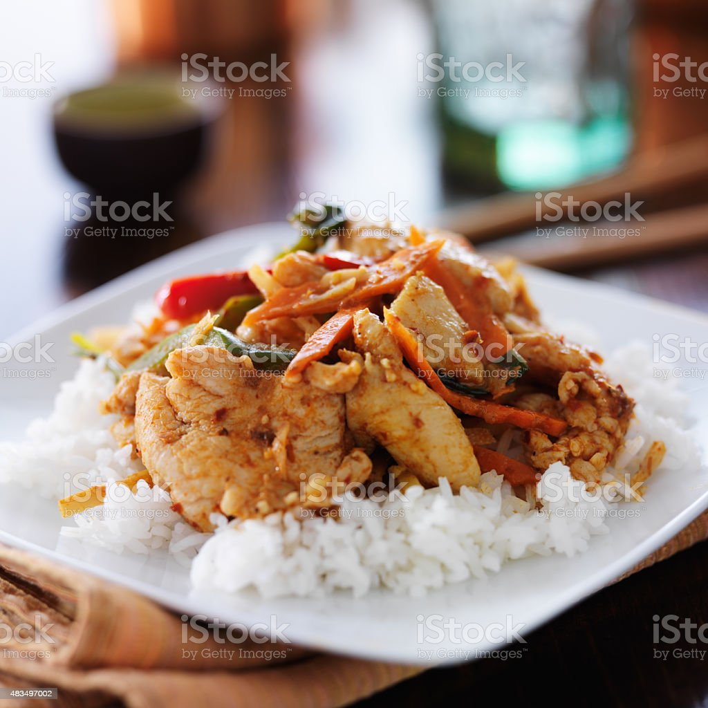 thai red curry with chicken and rice stock photo