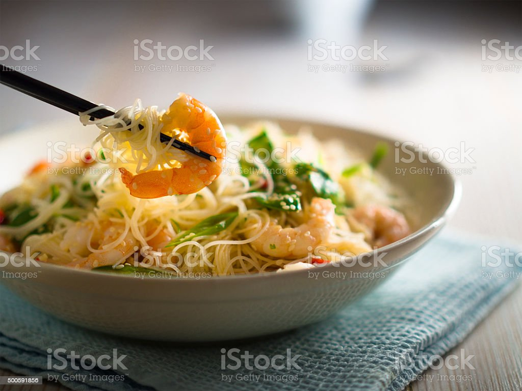 Thai rice noodle salad with prawns stock photo