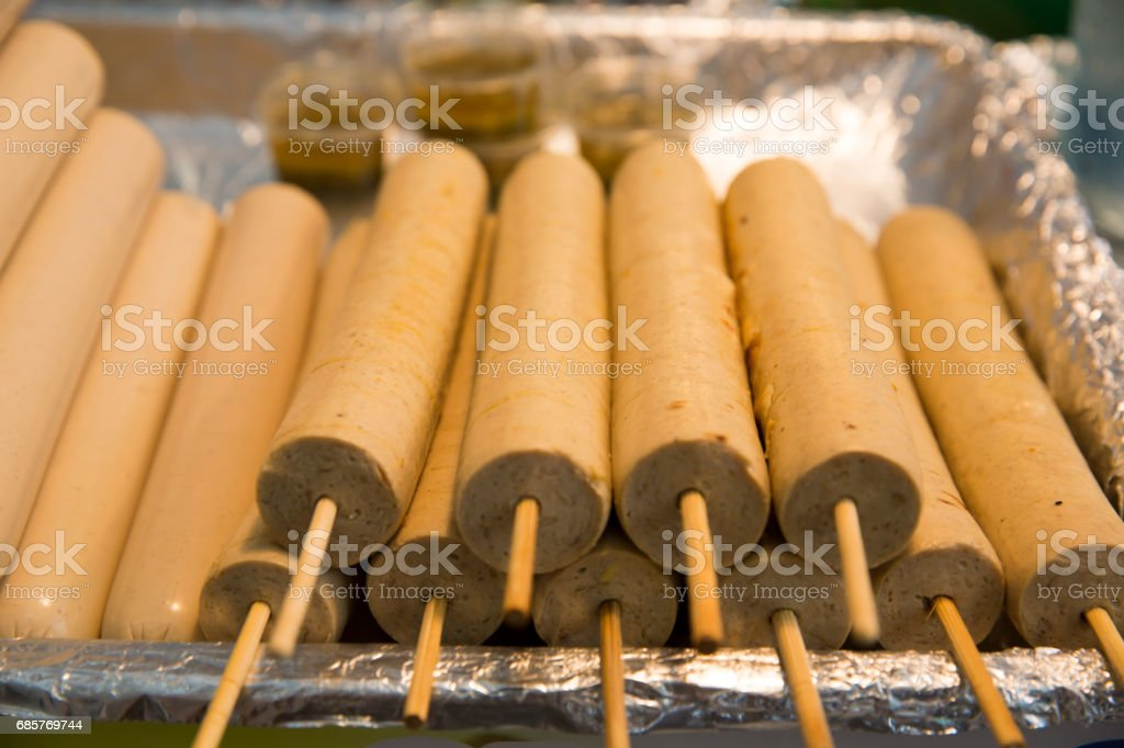 Thai sausage with bamboo stick, in a basket. stock photo
