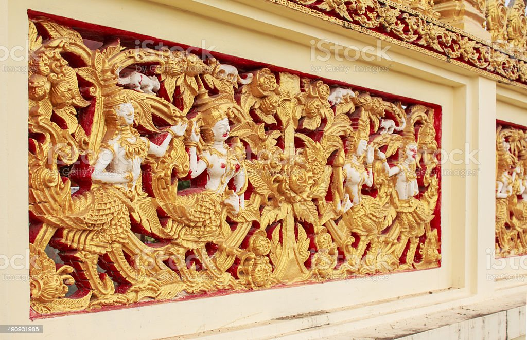 Thai sculpture on the temple wall stock photo