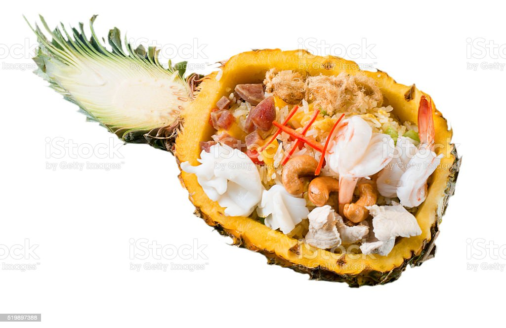 Thai seafood fried rice served in pineapple stock photo