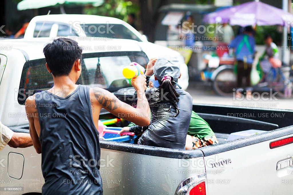 Thai shooting water gun at Songkran stock photo