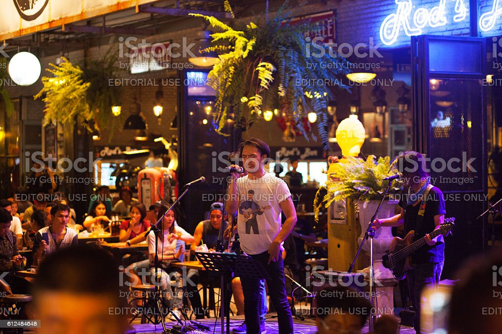Thai singer and band outside of bar stock photo