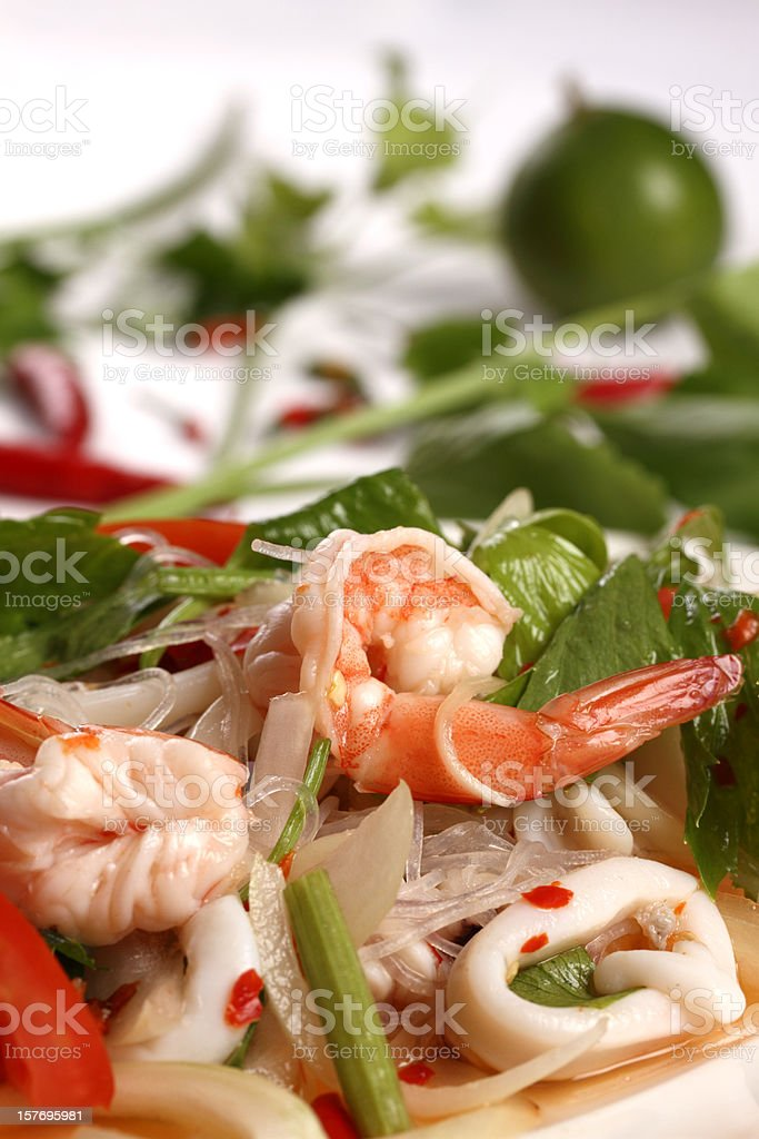 Thai spicy seafood noodle salad with fresh prawns stock photo