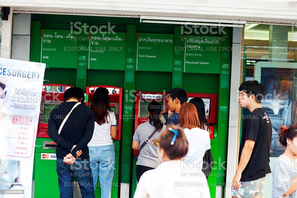 Thai standing in queue at ATM stock photo