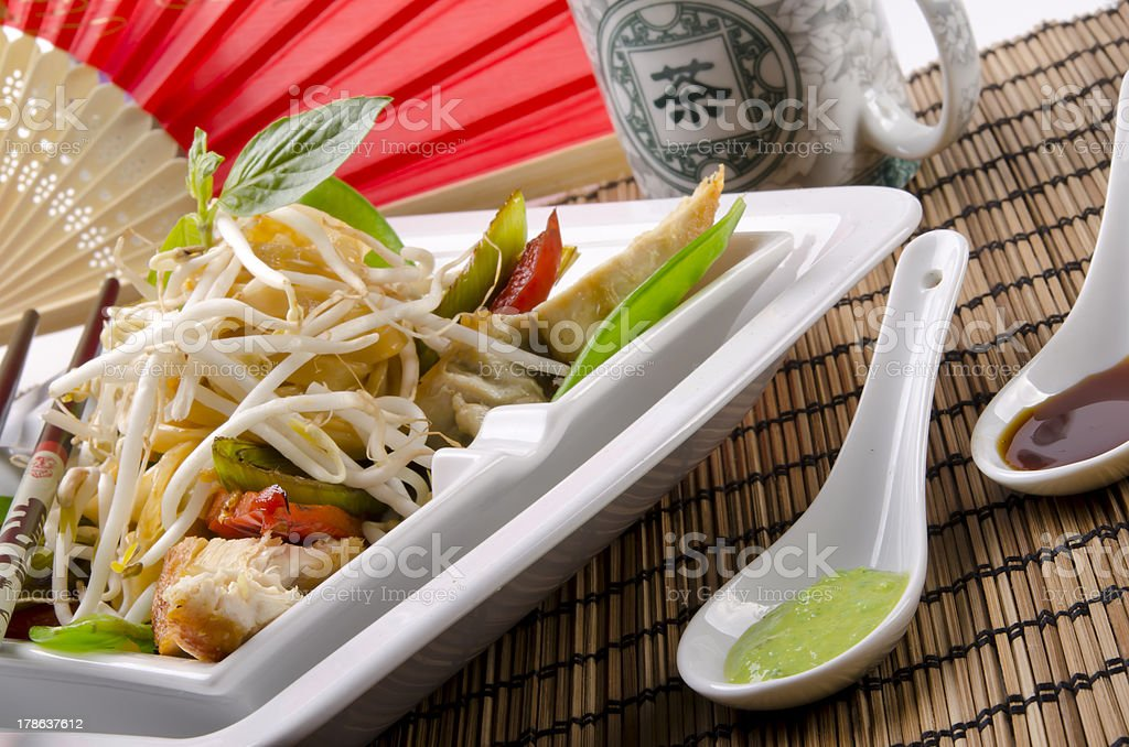 Thai stir fried food and chopsticks stock photo