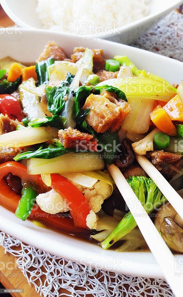 Thai stir fry: crispy pork with basil and vegetables stock photo