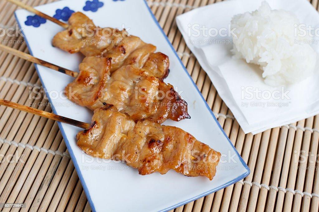 Thai street food. Roasted pork with sticky rice stock photo