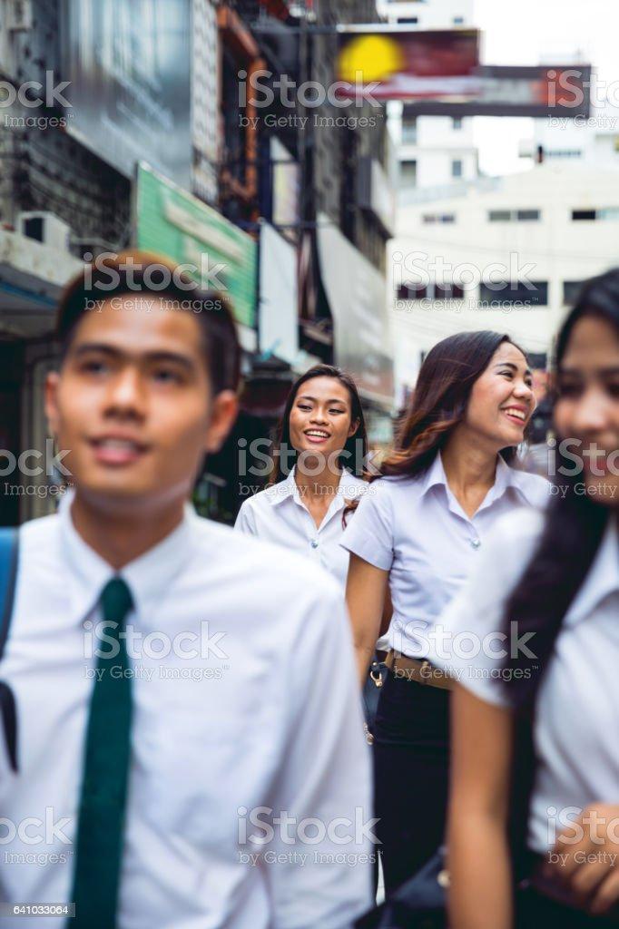 Thai students in uniform in Bangkok take a break together stock photo