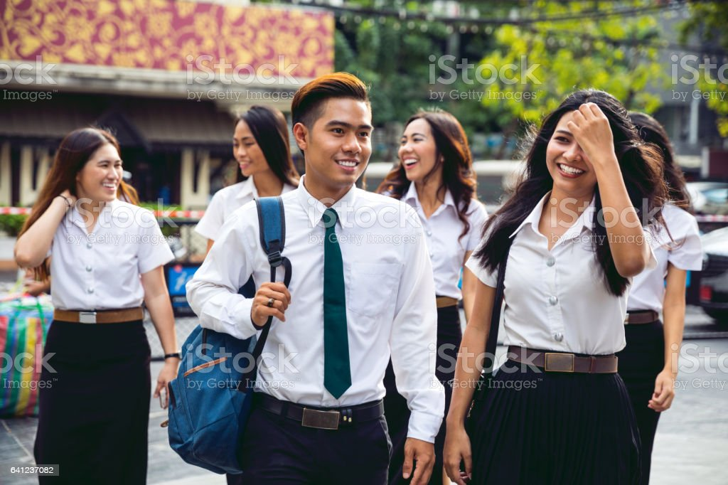 Thai students in uniform in Bangkok take a break together stock photo