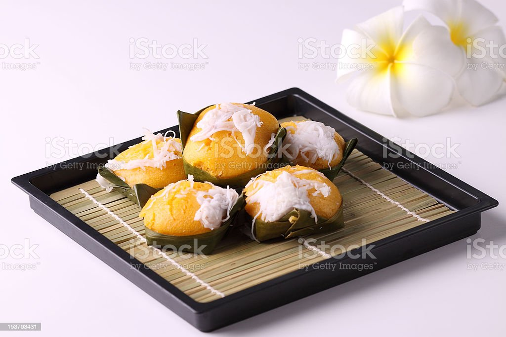 Thai style dessert wrapped in banana leaves royalty-free stock photo