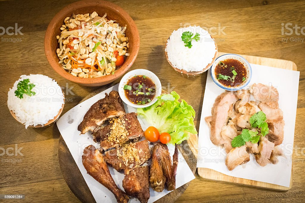 Thai style food : Papaya  salad  , Grilled chicken , Grilled por stock photo