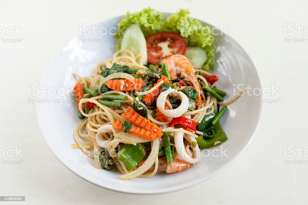 Thai style fried spagethi with spicy seafood stock photo